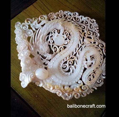 shell carving motif dragon